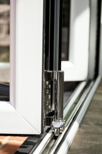 bi-fold door gliding mechanism